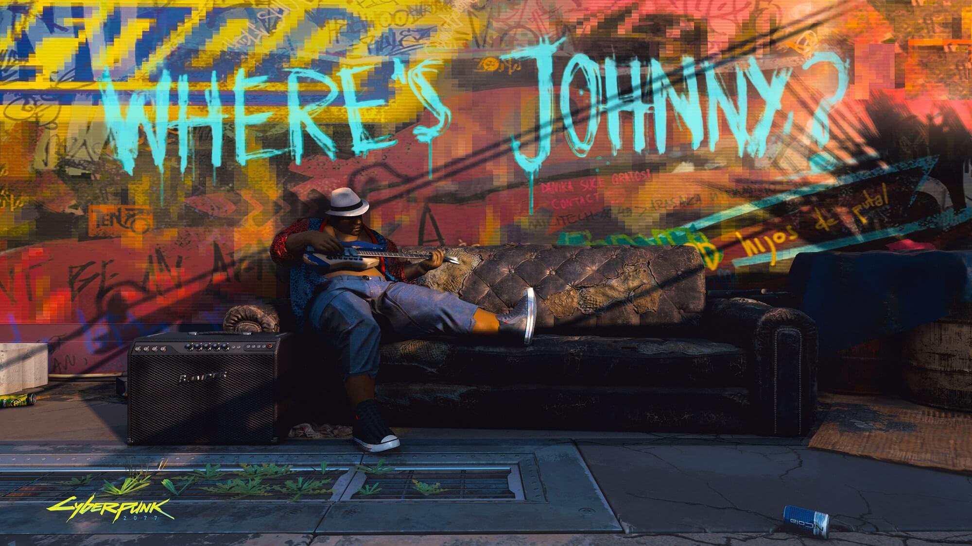 """Cyberpunk 2077: Musiker spielt Gitarre unter einem """"Where is Johnny"""" Grafiti"""